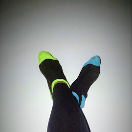Late Night Phone Conversations by Davina Michelle - People Body Parts ( sock, leading lines, body parts, blue, colors, green, socks, feet, legs, black, wall, leggings )