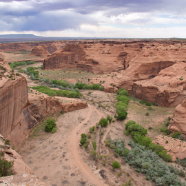 Canyon de Chelly by Phyllis Plotkin - Landscapes Caves & Formations ( clouds, rock formations, foliage, arizona, canyon, landscape, canyon de chelly, curving line )