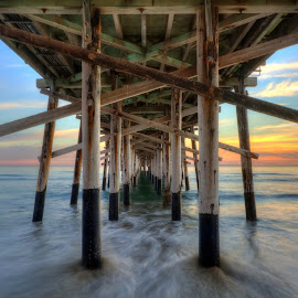 Newport Beach Pier by Eddie Yerkish - Buildings & Architecture Bridges & Suspended Structures ( exposure, water, sand, structure, wood, waterscape, waves, horizon, newport, ocean, seascape, beach, architecture, landscape, long, sun, suspended, nature, sunset, outdoors, pier, nikon )