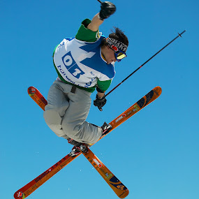 Cross-up! by Anthony Allen - Sports & Fitness Snow Sports ( ski's crossed, jumping, ski ramp, ski jump, cross-up, air, skier )