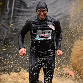 Happy Man by Marco Bertamé - Sports & Fitness Other Sports ( water, splatter, differdange, splash, 2015, number, soup, watermuddy, running, 1884, luxembourg, strong, happy, determined, brown, strongmanrun, man, black )