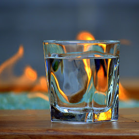fire in and out by Rima Biswas - Artistic Objects Other Objects ( life, whiskey, pwcfire, drink, glass, still, yellow, table, fire )