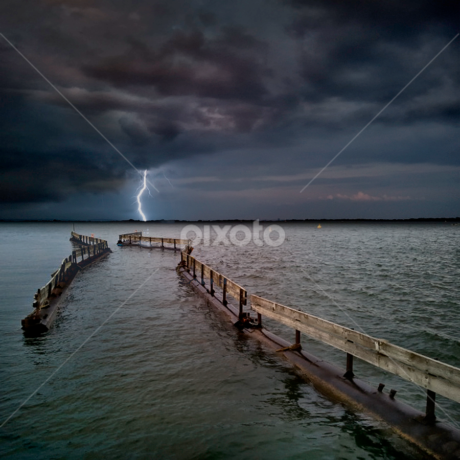 water fence by Marianna Armata - Landscapes Waterscapes ( clouds, water, fence, lightning, sky, lake, marianna armata, storm, evening )