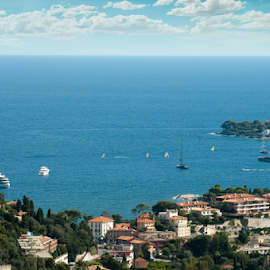 View of Monaco and many yachts in the bay by Deyan Georgiev - Landscapes Travel ( principality, riviera, harbor, yacht, french, architecture, travel, city, sky, lifestyle, buildings, marina, azure, tourism, holiday, european, vacation, bay, wealth, view, port, famous, europe, ship, carlo, monaco, seaside, monte, landscape, coastline, panorama, coast, sailing, mediterranean, france, sightseeing, water, building, rich, boats, sea, scenic, boat, yachts, luxury, urban, blue, monte carlo, casino, scenery )