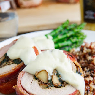 Bacon Wrapped, Mushroom and Spinach Stuffed Pork Tenderloin in a Creamy Dijon Goat Cheese Sauce