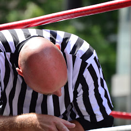 The Ref by Thomas Shaw - People Musicians & Entertainers ( ring, wrestling, white, bald, stripes, wrestling ring, pro wrestling, gouge pro wrestling, refree, and, red, gouge wrestling, ropes, head, black, man )
