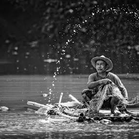 Fisherman Rafting by Nassery Naz - People Portraits of Men ( senior citizen )