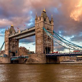 Beautiful Sky over Tower Bridge by Jan Murphy - Buildings & Architecture Bridges & Suspended Structures ( water, buses, clouds, orange, flags, windows, historic, landmark, sky, london, thames, blue, sunset, tower bridge, buildings, bridge, river,  )