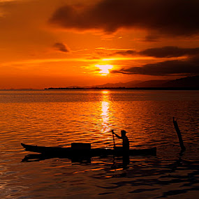 Pulang by Asirah Abrah - Landscapes Sunsets & Sunrises ( water, reflection, sky, blue, sunset, cloud, fishing, boat, fisherman, waterscapes, lanscapes, sun )
