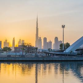 Golden hour at Dubai Canal by Zulfikar Khan - Buildings & Architecture Bridges & Suspended Structures ( orange, building, sunrise, bridge, canal )