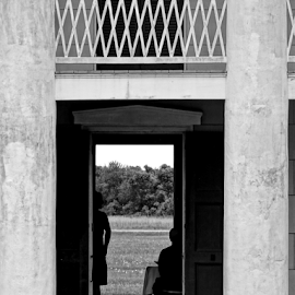 Looking Back by Gary Ambessi - Black & White Buildings & Architecture