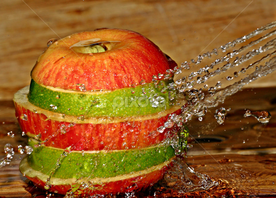 Water splash on an apple. by Dipali S - Food & Drink Fruits & Vegetables ( water, red and green, spray, splash, apple, lime,  )