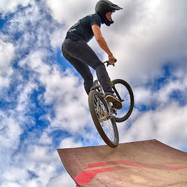 Twisting Jump by Marco Bertamé - Sports & Fitness Other Sports ( clouds, wood, speed, letter, a, dow, take-off, stunt, jump, bicycle, ramp, red, blue, twist, cloudy, brown )