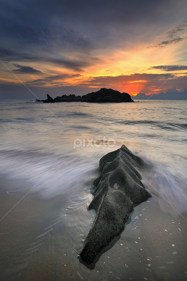 lie down... by Azam Alwi - Landscapes Waterscapes ( stone, malaysia, sunrise, beach, kijal terengganu, bora-bora, slow shutter )