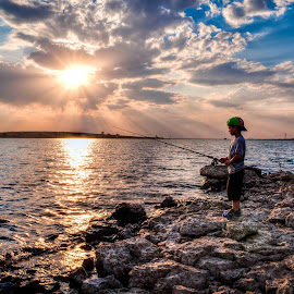 Fisherman by Mardus Davel - Landscapes Waterscapes ( clouds, child, sunset, fishing )