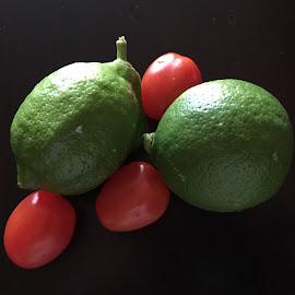 Limes and Tomatoes by Lope Piamonte Jr - Food & Drink Fruits & Vegetables