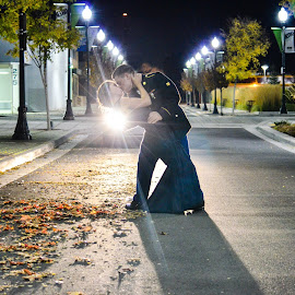 3 People and 2 Dogs by Sara Shelton - People Couples ( army, kissing, street, streetlights, national guard, military )