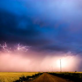 Storm Down a Lonely Road by Glenn Patterson - Landscapes Weather ( lightning, sky, purple, thunderstorm, green, weather, yellow, road, storm, dirt )