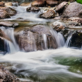 A Smooth Gush by Alí AWaís - Nature Up Close Water ( water, aliawais, stream, nature, nikon, longexposure, rocks )
