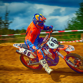 Sixty-Six by Marco Bertamé - Sports & Fitness Motorsports ( curve, orange, 66, sixty-six, number, race, motocross, blue, dust, clumps, alone, accelerating, competition )