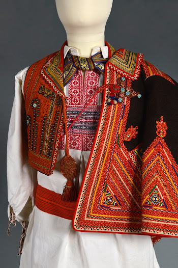 <b>The Balkans: 1800s - 1900s</b>  Much of the area was formerly governed from Istanbul as part of the Turkish Ottoman Empire. Different regions secured independence from it in a series of wars in the late 1800s and early 1900s. The jewellery and dress shown  in the exhibit was mostly produced in this period, during the collapse of the Ottoman Empire, and reflects the emerging nationalistic sentiment of the time.   Communication was extremely difficult before the creation of passable roads during the 1920s and 1930s. Settlements were isolated and people belonging to different ethnic, linguistic, or religious groups – Albanian and Serb, Christians and Muslims – lived in close proximity to one another in neighbouring villages.
