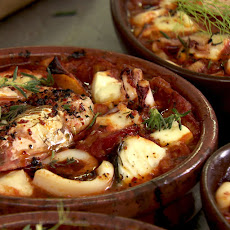 Baked seafood with tomatoes and Turkish cheese