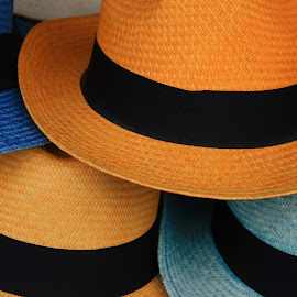 Yellow and Blue Hats by Robert Hamm - Artistic Objects Clothing & Accessories ( abstract, panama hat, otavalo, craft, market, ecuador, colorful, color, texture, outdoor, shape, straw hat, hat,  )