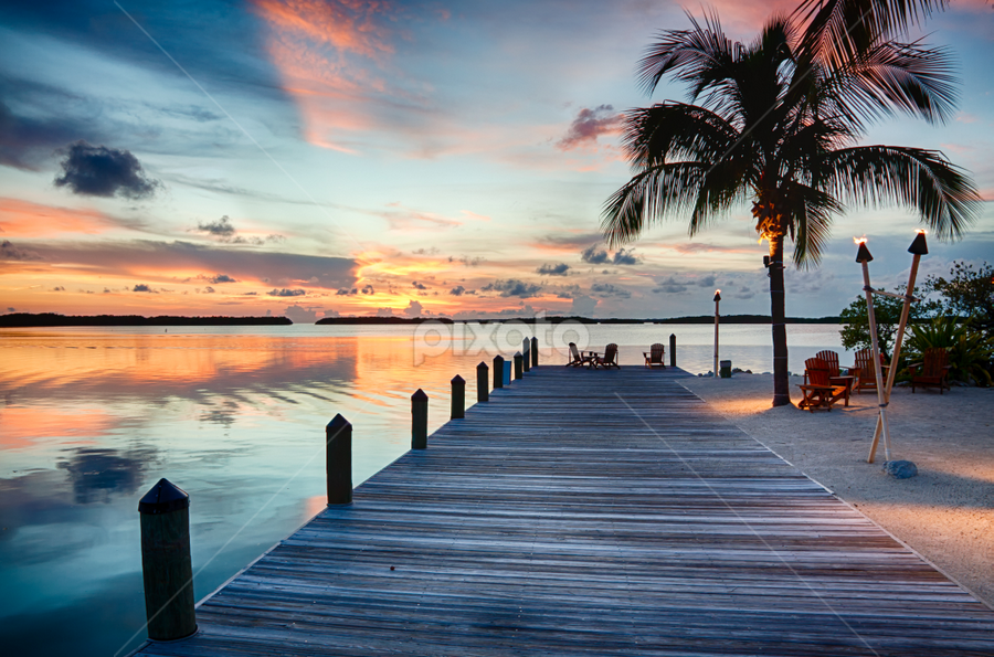 Islamorada Sunset Reflection by Tim Azar - Landscapes Travel ( clouds, water, islamorada, orange, reflection, hdr, tim azar, florida keys, nik dfine, ocean, yellow, sunlight, landscape, hdr efex pro 2, dock, sky, blue, sunset, florida, pier, cloudy, 3 exposures, pink, islamorada fish company )