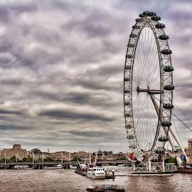 London eye by Gianluca Presto - City,  Street & Park  Vistas ( clouds, london eye, sky, london, boats, weather, cloudy, architecture, cityscape, city park, river, city )