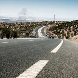 Highway outside the city by Deyan Georgiev - Landscapes Travel ( countryside, nobody, mountain, highway, freedom, line, way, travel, road, transportation, landscape, sky, nature, transport, speedway, sunny, drive, perspective, trip, motion, hill, asphalt, speed, grass, green, horizon, journey, dusk, rural, country, roadway, destination, traffic, blue, route, outdoor, background, meadow, summer, cloud, scene, view, sunrise, scenery, freeway )