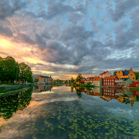 L i l i e s by Manu Heiskanen - Uncategorized All Uncategorized ( water, clouds, tower, relfection, oldcity, sunset, lilies, eskilstuna, cityscape, paulinawolekpardon )