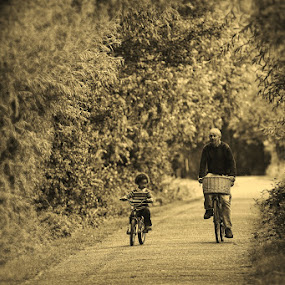 When I was your age... by Peter Parker - People Family ( grandchild, cycle, sepia, old, bike, granddad, grandfather, path, marina, young, bicycle )