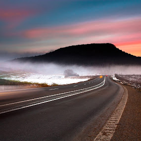 All roads lead to unknown by Eduard Moise - Landscapes Travel ( car, hill, sunset sky, fog, road, motion, misty )