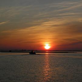 sunrises over ocean city  by Petrina Grimes - Landscapes Sunsets & Sunrises ( water, red, blue, sunrise, boat,  )