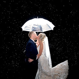Kissing in the Rain by Sandra Clukey - Wedding Bride & Groom ( rainy day, raindrops, bride and groom, wedding couple, rain )