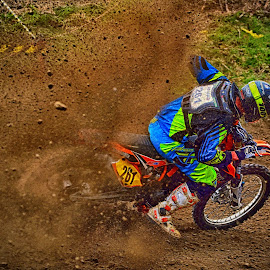 Overdriving by Marco Bertamé - Sports & Fitness Motorsports ( curve, 261, slittering, number, race, overdriving, two hundred sixty-one, motocross, dust, clumps, alone, accelerating, competition,  )