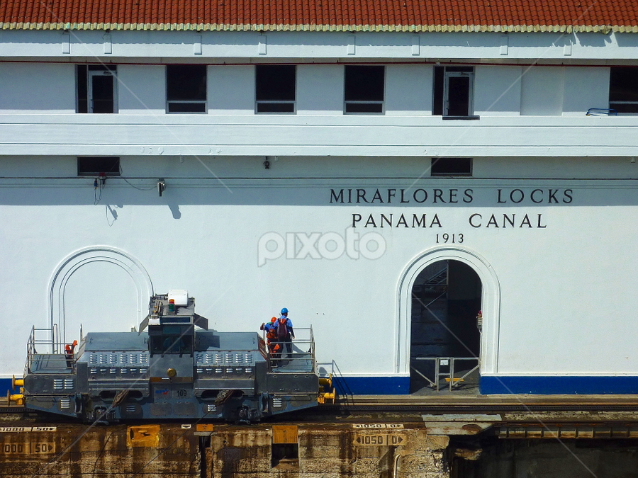 Locomotive Operators At Miraflores Locks by Leigh Thomson - Professional People Technology Workers ( building, technology, trade, engine, travel, transportation, workers, canal, panama, shipping, landmark, transport, locomotive, locks, train, ships, miraflores, central america )
