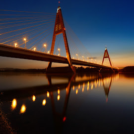 Bridge in the evening by Cvetka Zavernik - Buildings & Architecture Bridges & Suspended Structures ( sunset, night, bridge, river, water, lights )
