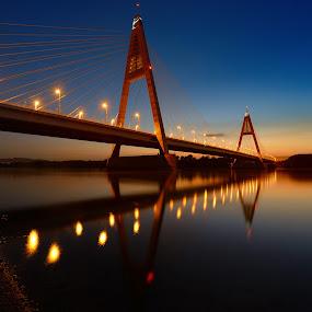 Bridge in the evening by Cvetka Zavernik - Buildings & Architecture Bridges & Suspended Structures ( sunset, night, bridge, river, water, lights )