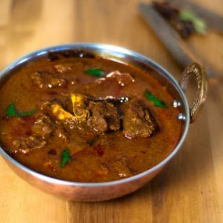 Mutton Varutharacha Curry (Goat meat in a fried Coconut Gravy)