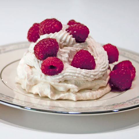 Meringues with Liqueur Flavored Whipped Cream and Raspberries