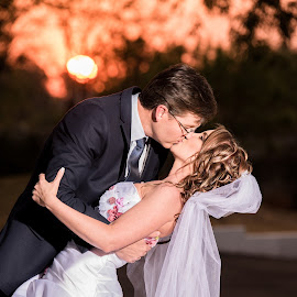 sunset kiss by Junita Fourie-Stroh - Wedding Bride & Groom ( kiss, wedding photography, wedding day, sunset, wedding, wedding dress, professional wedding photographer, bride and groom, bride, groom, destination wedding photographers )