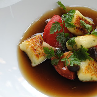 Wild Mushroom Consommé With Herb Gnocchi, Confit Tomatoes And Pickled Mushrooms
