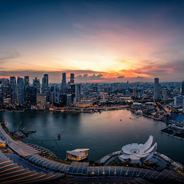 Singapore Skyline and view of skyscrapers on Marina Bay at sunse by Nuttawut Uttamaharach - City,  Street & Park  Skylines ( commercial, city, dusk, financial, exterior, skyline, building, east, view, modern, cityscape, hotel, bay, skyscrapers, architecture, tower, sky, famous, business, reflection, wheel, asia, center, night, tree, downtown, singapore, marina, panorama, urban, light, sunset, silhouette, bridge, river, evening, travel, finance, landscape )