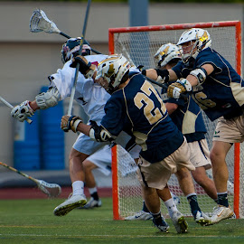 Taking one for the team...from a teammate by Kevin Mummau - Sports & Fitness Lacrosse ( defense, airborne, crosscheck, win, lacrosse )