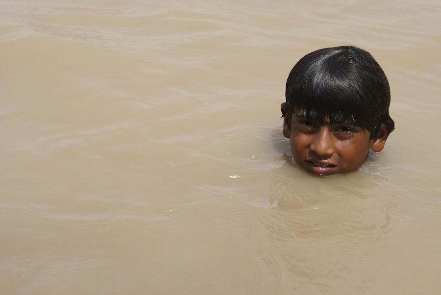 floating head by Bisma Akbar - News & Events World Events ( water, boy )