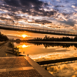 Sunset by Daniel Chobanov - Landscapes Sunsets & Sunrises ( clouds, plovdiv, winter, sunset, reflections, rowing_channel, sun, bulgaria )