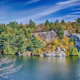 Fall Foliage at Lake Minnewaska by Debbie Quick - Landscapes Waterscapes ( ulster county, debbie quick, color, seasonal, cliff, debs creative images, trees, fall, rocks, season, pine trees, kerhonkson, rocky terrain, lake minnewaska, waterscapes, tree, preserve, rugged, new york, water, foliage, colour, autumn, hudson valley, colorful,  )