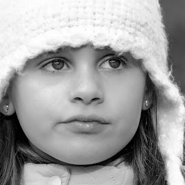 Through a child's eyes by Brent McKee - Babies & Children Child Portraits ( child, winter, girl, black and white, fuji, beanie, cute, sydney, eyes )