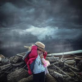 Storm by Una Williams Photos - Babies & Children Children Candids ( clouds, child, doll, logs, weather )